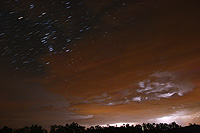 startrails orion and thunderstorm